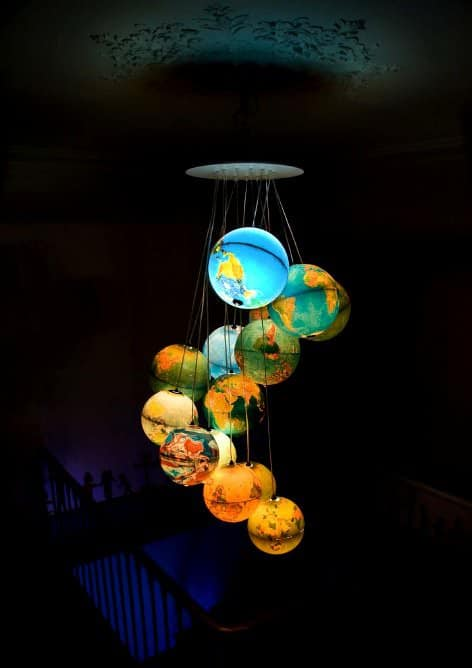 World Inside Out: A Chandelier Made Out Of Recycled World Globes 1 • Lamps & Lights
