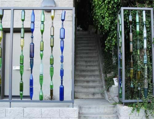 Garden Fence with Recycled Glass Bottles 1 • Garden Ideas