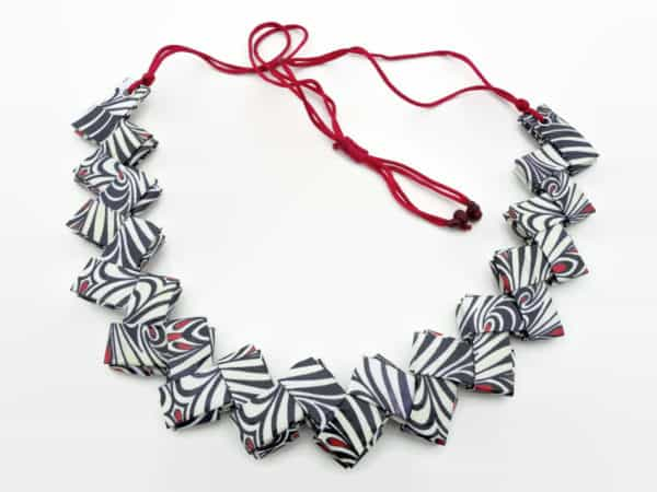 Origami-paper-necklace-with-black-and-white-stripes-zig-zag-shaped
