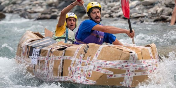 July 5, 2015: Cardboard rafts race down Fiume Dora Riparia for the 2015 Carton Rapid Race in Cesana, Italy.