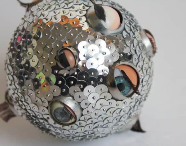 Upcycled Doll Projects - use closing eyes from doll heads in these interesting ornaments!