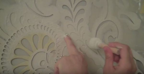 Wall Stencils never sit flush against the wall. You'll have to apply a little pressure with your free hand to ensure that the stencil will be flush against the wall.