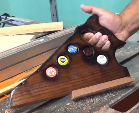 This Table Saw Push Stick features embedded bottle caps as a decorative feature.