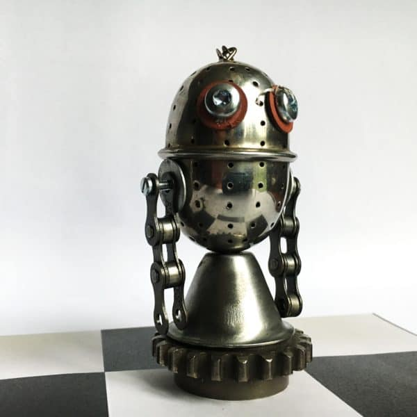 How cute is this little guy? His body is a big tea ball, his arms are pieces of chain attached by screws, and his base is a gear set. Washers make his eyes brown, too.