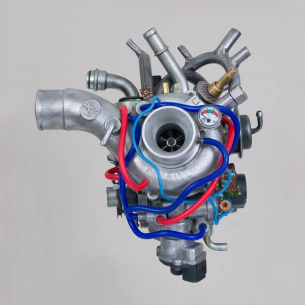 Heart art is represented here by a water pump, turbo pump, and other miscellaneous pieces of cars to create a realistic, yet artistic version of the heart.