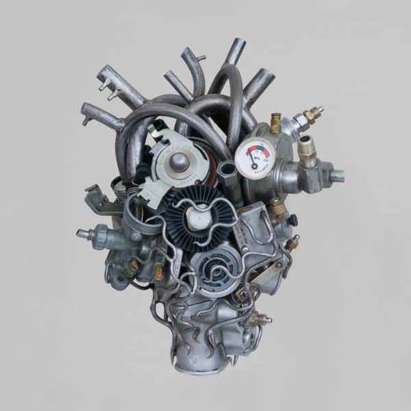More heart sculptures made out of different car parts.