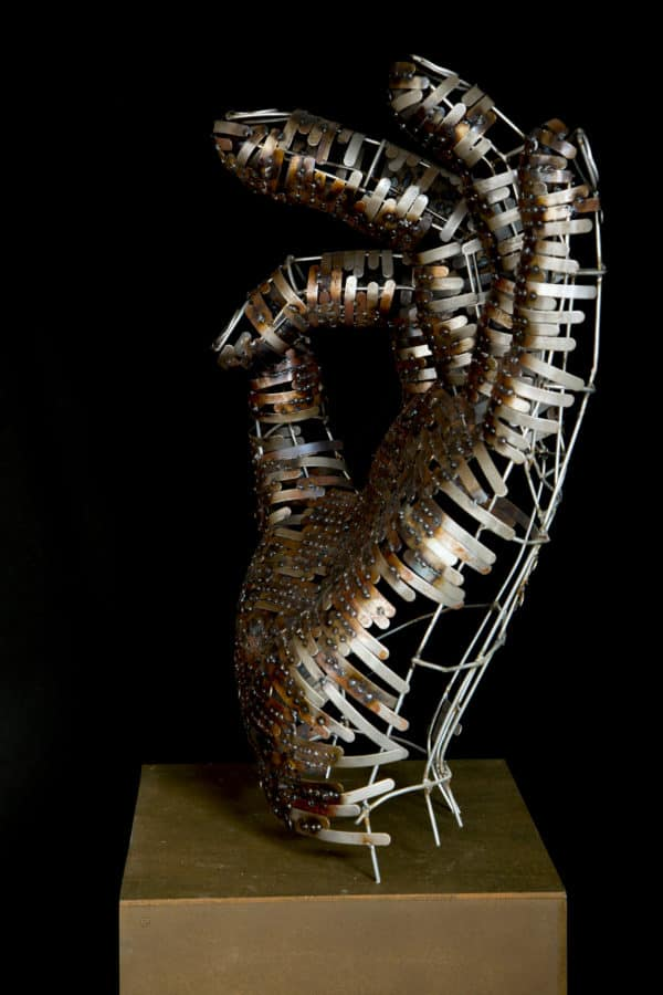 This beautiful hand sculpture highlights the beauty of the metal in this series of Upcycled Metal Sculptures.