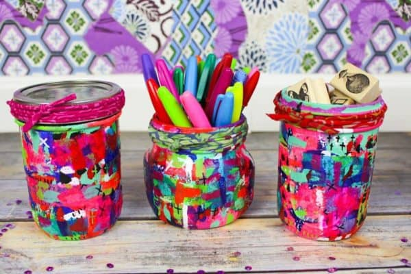 Customize these Upcycled Mason Jars any way you want. Add sisal, twine, ribbon or pretty cloth to the lids. Mix any color palette to create unique storage solutions.