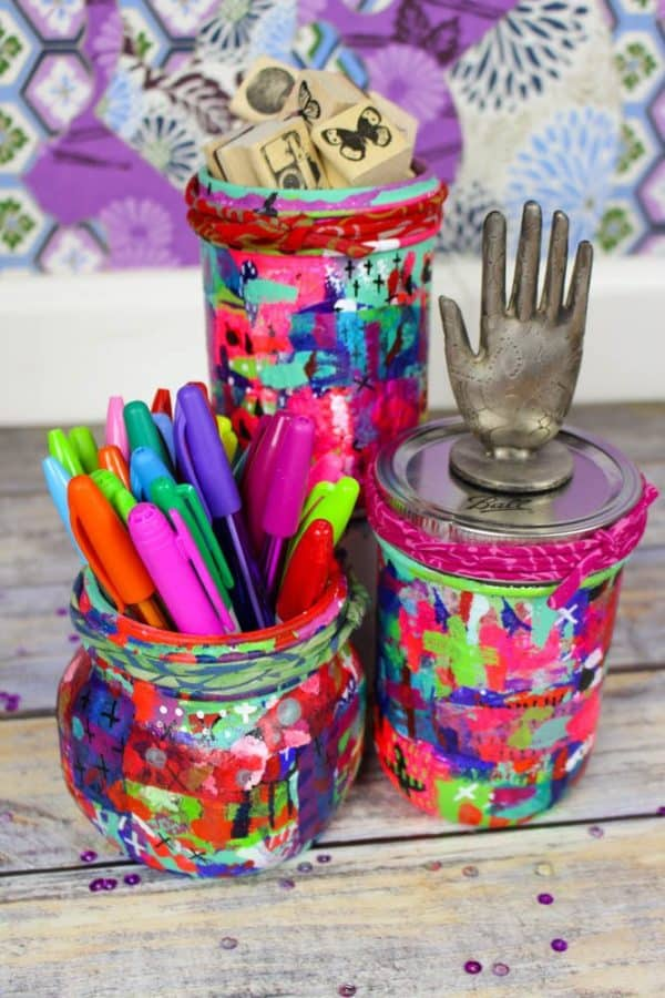 These Upcycled Mason Jars make a bright, eclectic splash of color to any room, and would make amazing gifts.