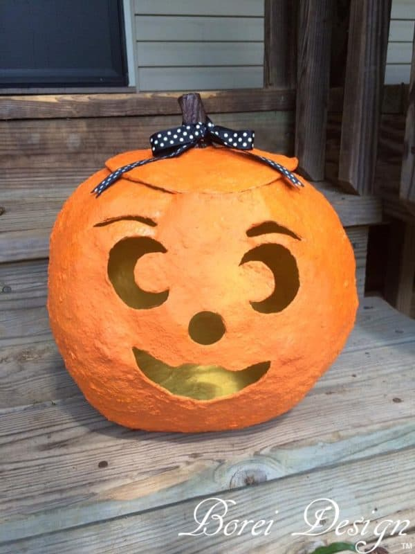 Add a bit of ribbon, a small piece of tree branch and make a cute, decorative stem on top of your Jack O' Lantern