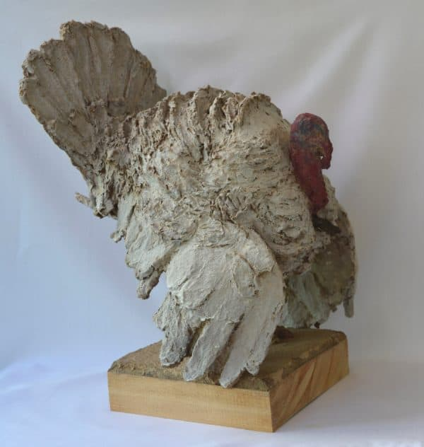 This Cardboard Turkey Sculpture is made from upcycled cardboard that was turned into paper mache.