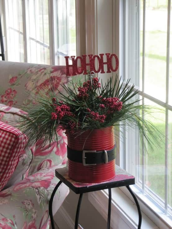 Upcycle large cans into santa-themed planters -an excellent addition to your Christmas Decorations.