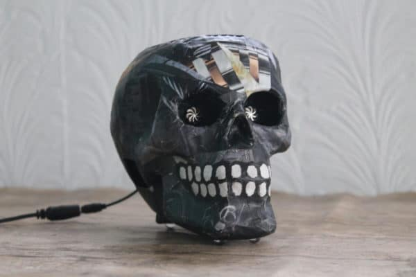 This skull lamp is one of my 3-d Upcycled Paper Wall Art pieces.