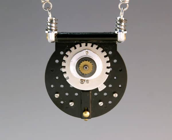 This piece of Camera Jewelry is made from a gear set.