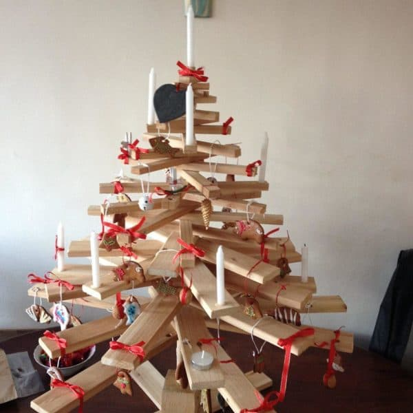 Pallet Mini Christmas Tree is a beautiful natural-wood backdrop that makes any ornament, from the simples ribbon, look beautiful.
