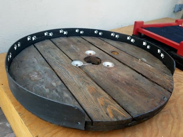 Upcycled Dog Beds can be made from the spool end with a bit of plastic or rubber wrapped around the back to keep cushions in place.