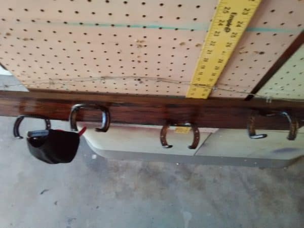 This Horseshoe Hat Rack upcycles old horseshoes and a beautifully cracked Cedar plank.