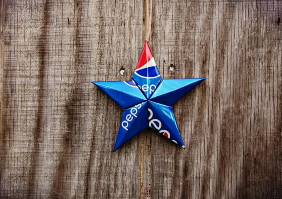 Upcycled Christmas Ideas like this Pepsi can start add a bright bit of color to your holiday decor.