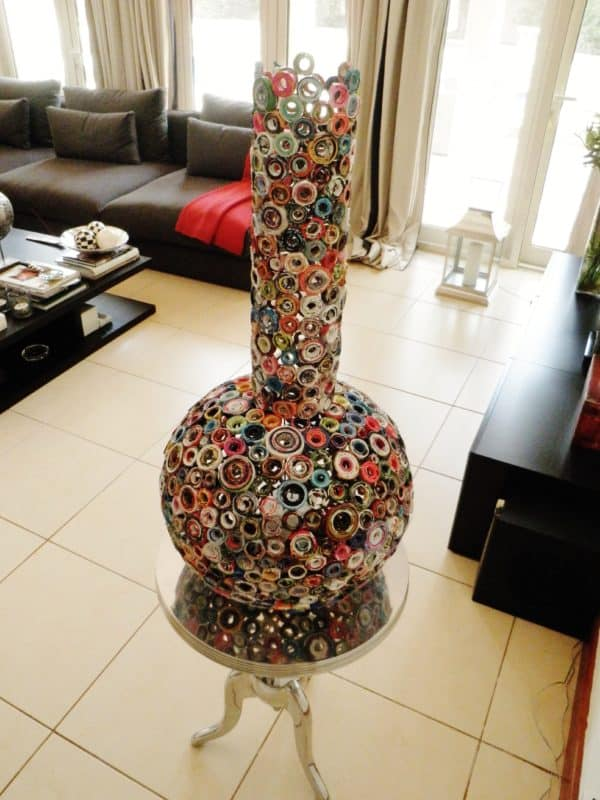 Recycled Art Projects include this upcycled magazine art vase. Each circular segment is coiled paper!