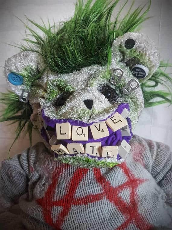 """The teeth spell """"love"""" and """"hate"""" in this Punk Bear's mouth."""