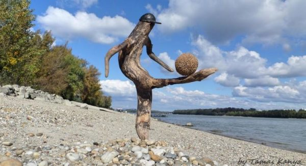 Driftwood Art like this soccer player will make you smile.