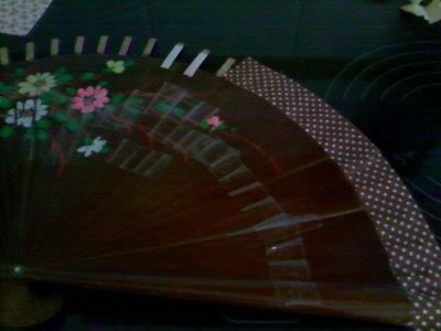 I upcycled some ribbon and glued it on over the exposed ends of the Fan. I had to cut the ribbon into several small pieces to create the proper curve without creating wrinkles.