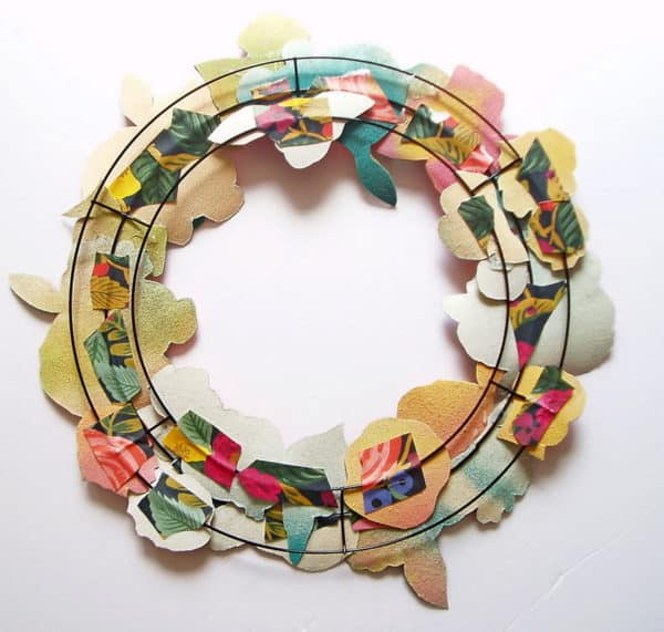 I used a wreath frame that you can find reasonably at discount stores, or use scrap wire and make your own Gift Wrap Wreath frame.