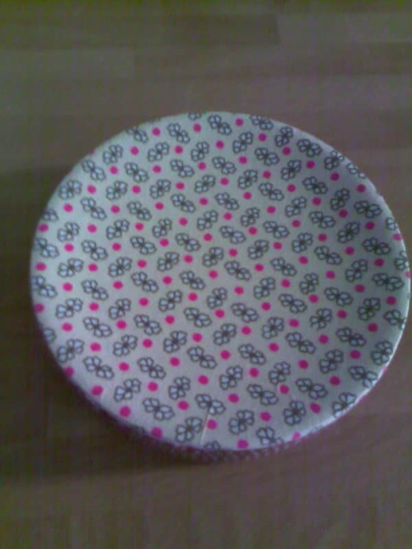 The adhesive cloth is attractive and helps stabilize the soapstone dish into a functional trivet.