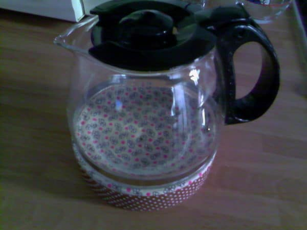 My upcycled becomes a functional coffee pot trivet that looks great on my dining table.