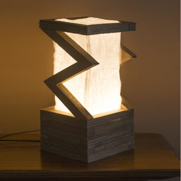 This Cardboard Lamp makes a stunning visual statement, and the LED light kit stays cool!