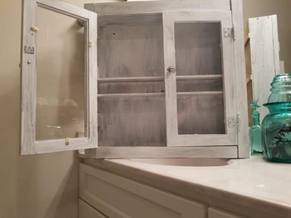 The glass doors on this Bathroom Cabinet lets you display collectibles or your backup bathroom supplies with ease.