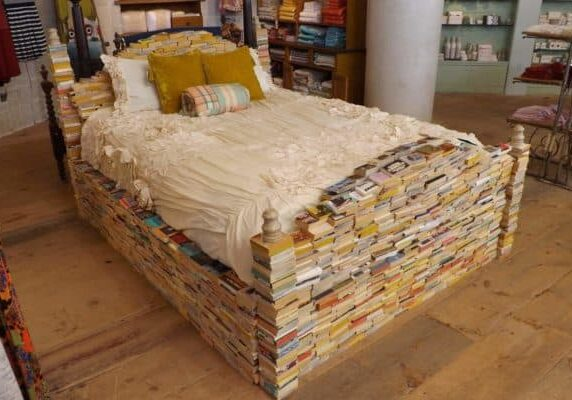 bedframe of paperback books