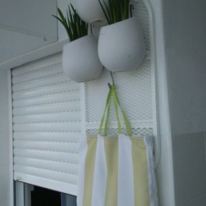recyclart.org-creative-upcycled-ironing-board-plant-stand-01