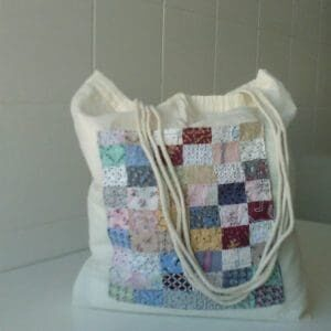 This cute bag would be an amazing gift for that grad, someone going on an extended trip, or family/friends moving away. Give them a piece of home and upcycle old material in a fun and clever way.