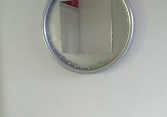 I painted this mirror frame silver after cleaning it, then added decorative little baubles around the inner edge of the frame.